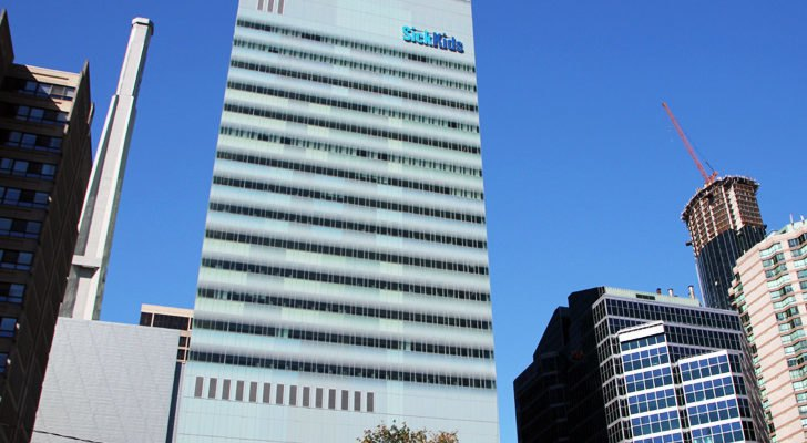 A tall SickKids building with 230 labs