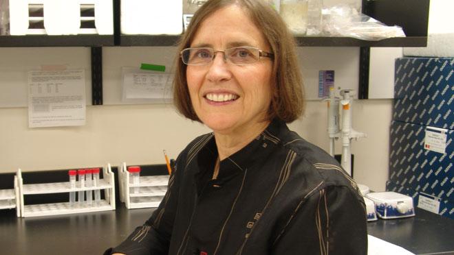 Director of HSNRI is smilingin the lab