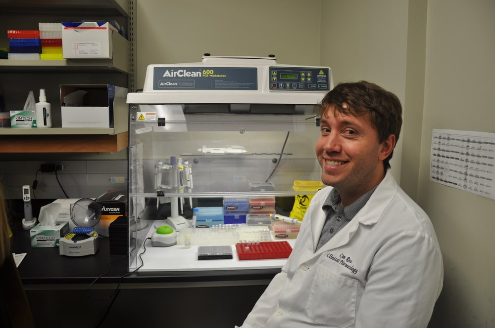 Cameron Ross sitting in the genotyping lab