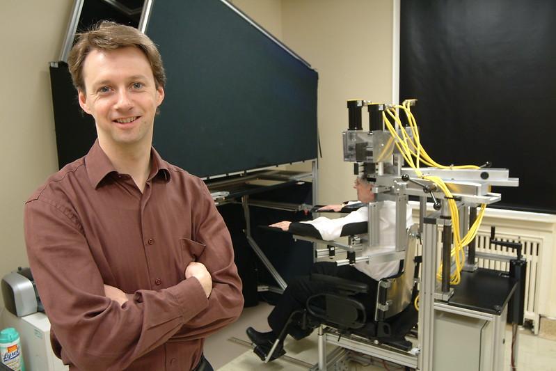 Scientist testing KINARM at the lab