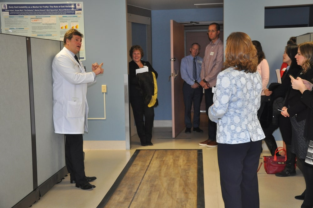 Executive Director of CAHO walks down the sensor mat at clinic