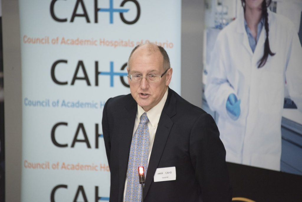 Dr. David Hill speaking from the stage