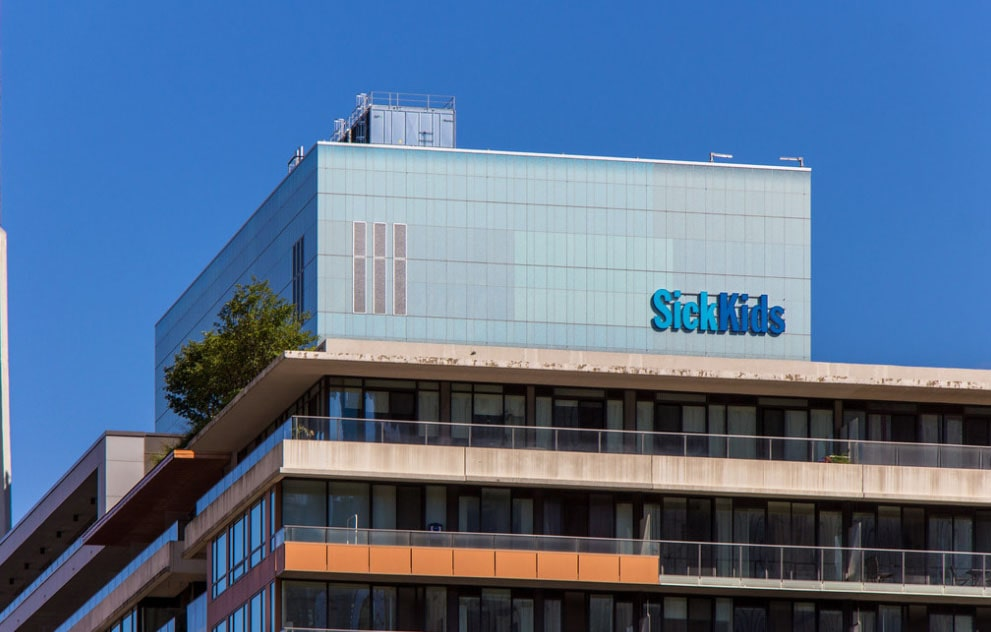SickKids building stands behind the other structur